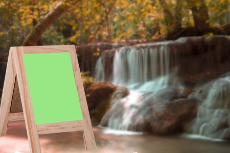 copy writing: greenboard on a blurred background waterfall Background for display or montage products Stock Photo