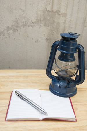 hurricane lamp: Tra Giang old notebook and pen blurred abstract background. Stock Photo