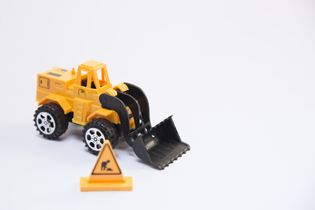 Dump truck unloads soil on the sand at a construction site Stock Photo - 52280839