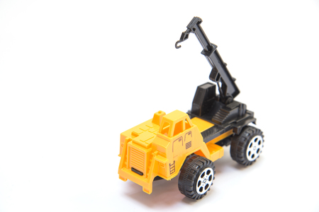 tonnage: Crane toy yellow background white Stock Photo