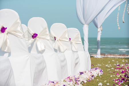arranging chairs: Beautiful flower wedding decoration in a thai