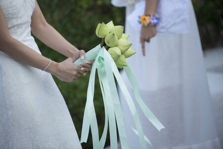 lustre: Bride from behind throw the bouquet from green  lotus