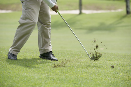 whiff: The ball rolled close to the hole as possible. Stock Photo