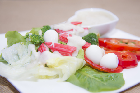 Salad with and vegetables sprinkled with grated cheese Stock Photo