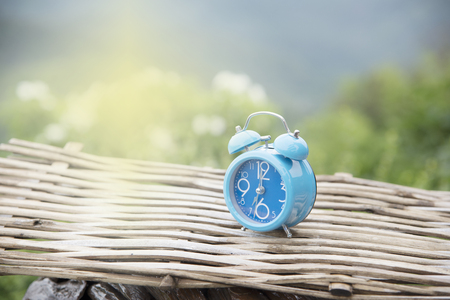alphabet holiday clock and blue blurred background scenery beautiful. Stock Photo
