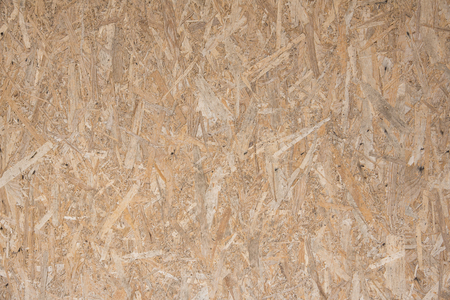 oriented strand board texture on grunge wood background
