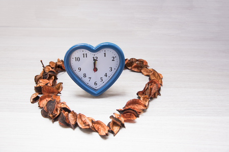 Clock, Straw flower on potpourri on Texture background