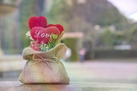 Red heart is in the sack, there is artificial light, background image, wallpaper.