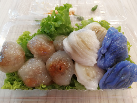 Steamed sago with pork and mixed vegetable on wood