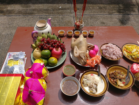 Sacrificial offering food for pray to god and memorial to ancestor in Chinese new year, Thailand.
