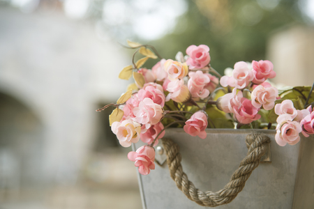Artificial flower with bright pots as a background or wallpaper. Stock Photo