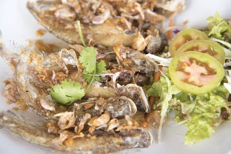 Deep Fried Fish with Garlic as a background or wallpaper.