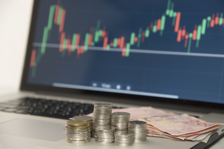 Trading Markets. Forex Currency Trading Concept with Computer Stock Photo