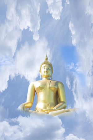 Large gold Buddha image in the sky and clouds.