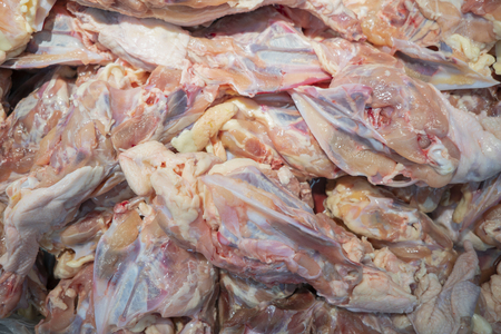 Chicken meat on the background after raw food.