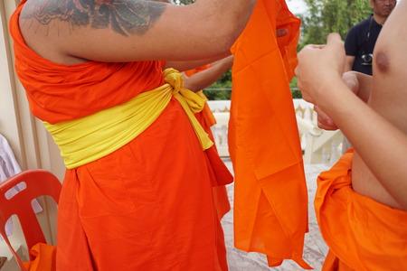 Yellow robe of Buddhist monk pattern background.
