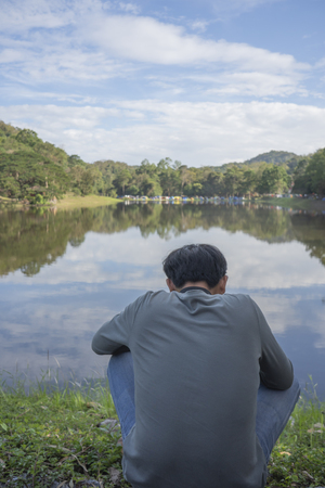People who do not see the face are watching the view in the reservoir. Stock Photo