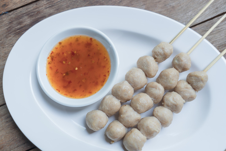 Pork meatballs with dipping sauce in a white dish Stock Photo
