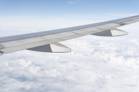 The plane wings are in the atmosphere of beautiful clouds Stock Photo - 117117824