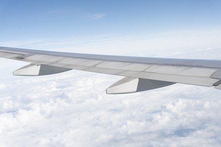The plane wings are in the atmosphere of beautiful clouds Stock Photo - 117117825