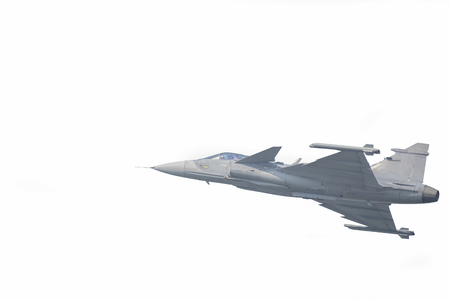 The Gripen plane above the horizon is a white background. Stock Photo - 118814497