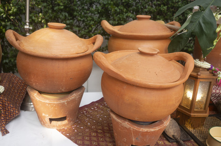 Concept of clean food. Thais traditional earthware pot Banco de Imagens