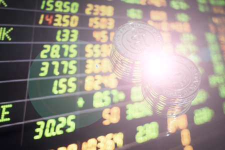 Currency, index investors in the stock market on the trading background