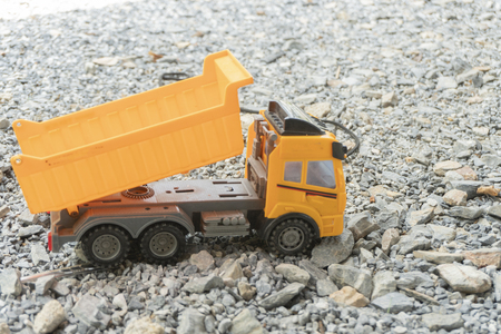 Children's loader plays on the rocky floor