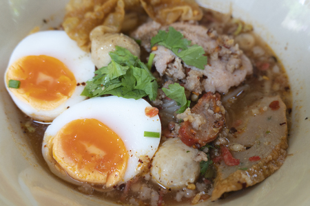 Tom Yum soup with eggs and  on a ready-to-eat dish
