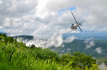 Helicopter Bell-212, UH-1 N Thai military flies into the sky.