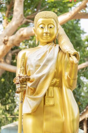 Big Buddha, golden color, abstract background