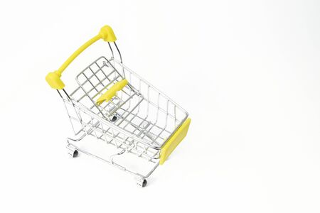 Small shopping cart in a white backdrop