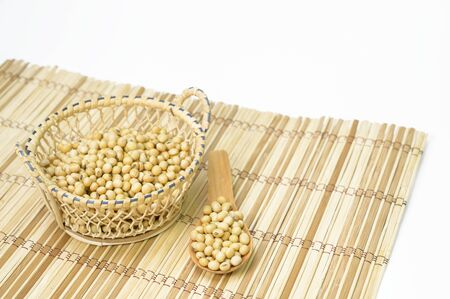 Soybean seeds on the floor, wood grain, white background 写真素材