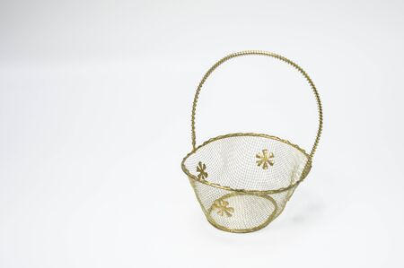 Empty metal baskets placed on a white background