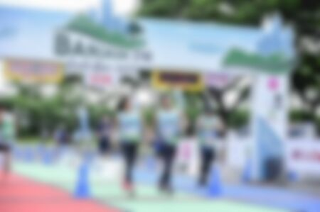 Many runners who are blurred and unspecified