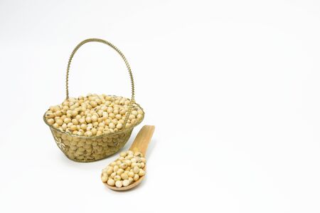 Instant soybean seeds, plants on a metal basket and a spoon on a white background Reklamní fotografie