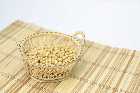 Soybean seeds on the floor, wood grain, white background Reklamní fotografie