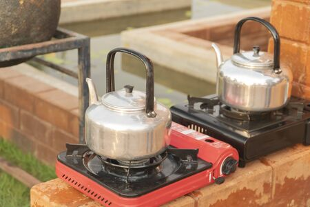 The kettle is placed on the gas stove.