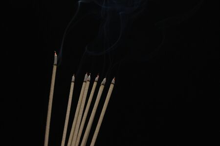 Incense and smoke on a black background Stock Photo