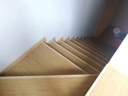 Beautiful wooden staircase styles in a modern floor house