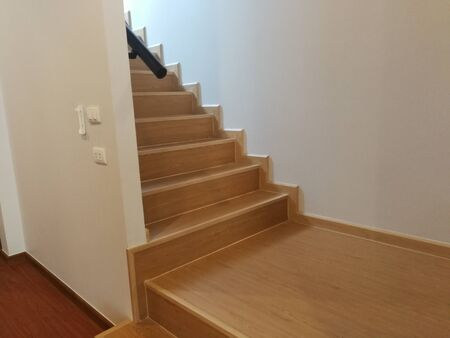 Beautiful wooden staircase styles in a modern floor house Stock fotó