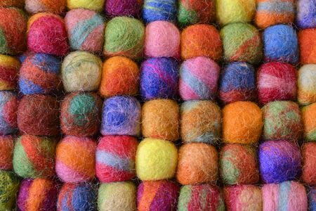 knitting wool on a colorful background