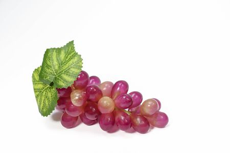 Red grapes invented on a white background Archivio Fotografico