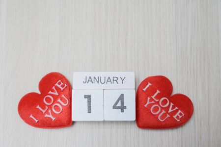 Hearts love you 14 february on wooden background
