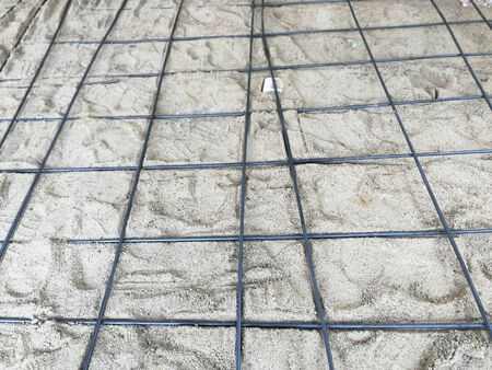 Steel structure grating on the floor with sand to make the car park