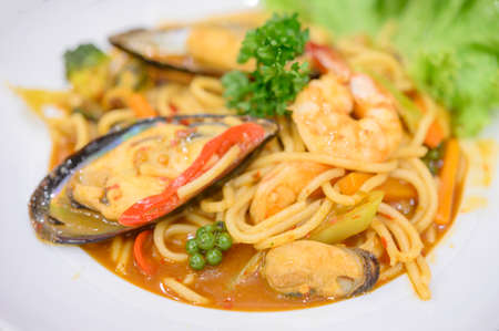 Seafood spaghetti pasta with mussels on white background Archivio Fotografico