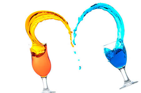 Cocktail glass with colorful liquor splashed at close distance, isolated on white Archivio Fotografico