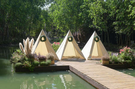 Three outdoor tents in the park against a natural backdrop. Archivio Fotografico