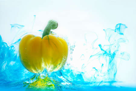 Yellow bell pepper, cut into pieces, splashes into the water. food ingredient concept Archivio Fotografico