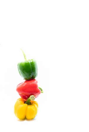 Three bell peppers stacked with cut-out background on food abstract.